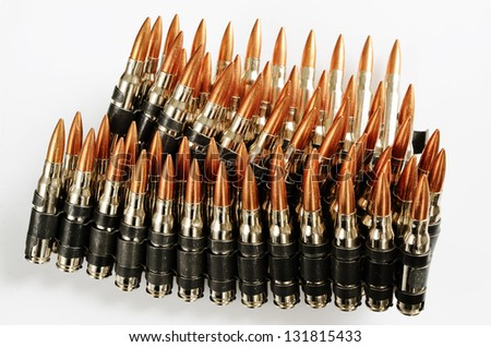 chain of bullets over white, closeup, horizontal - stock photo