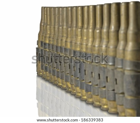 Chain of cartridges, used on the table. - stock photo