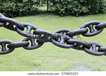 Chain of links of the old cast-iron in the park - stock photo