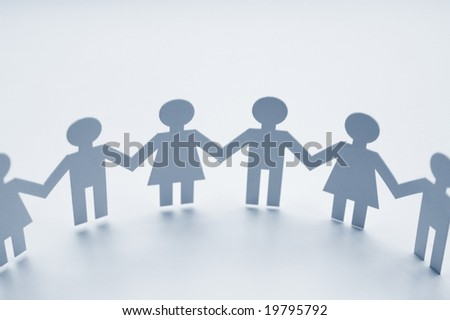 Chain of paper figures - stock photo