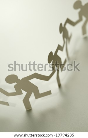 Chain of running figures - stock photo