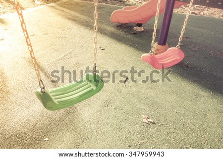 chain swings hanging in garden with morning light - stock photo