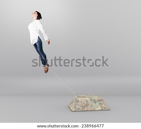 Chain with a heavy cargo on the legs of a girl - stock photo