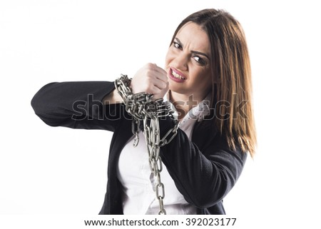 Chained  business woman trying to brake up the chains isolated on white background  - stock photo