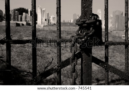Chained Cemetery Gate in B&W - stock photo