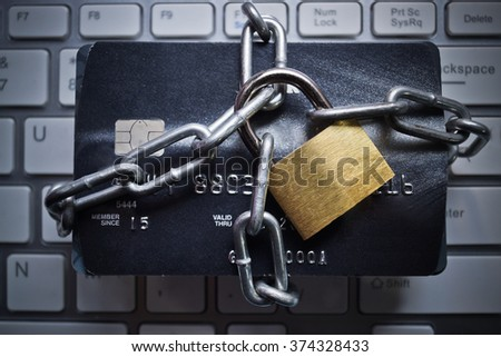 chained credit cards  - credit card data encryption protection concept - stock photo