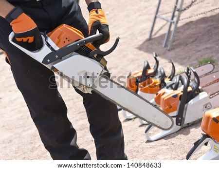 chainsaw in the hands of men - stock photo