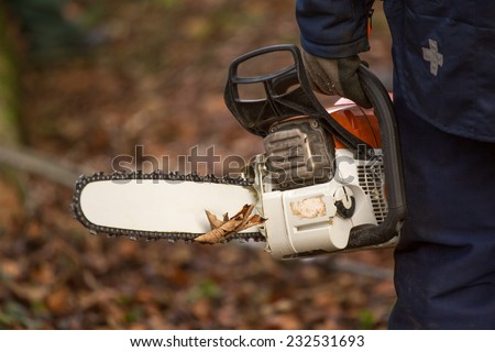 chainsaw in the woods - stock photo