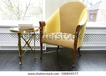 chair and a small table for books - stock photo
