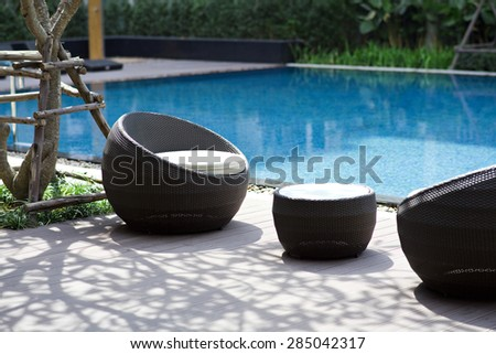 chair by the swimming pool - stock photo