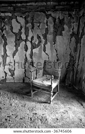 Chair in an abandoned cabin - stock photo