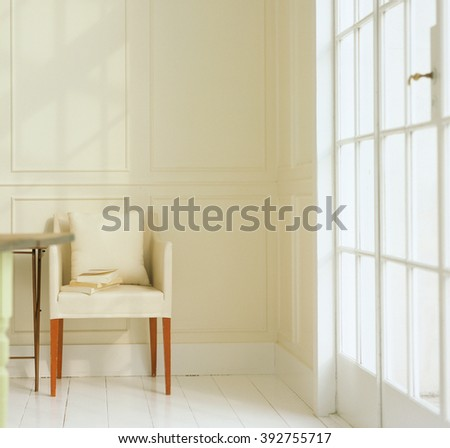 chair in an empty room - stock photo