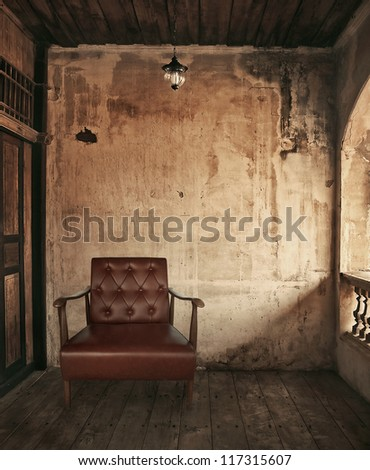 chair in old grunge room - stock photo