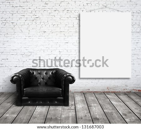chair in room and blank poster on wall - stock photo