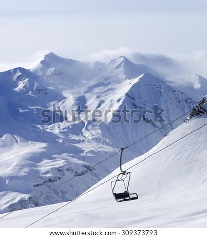Chair lift at ski resort. Caucasus Mountains, Georgia, Gudauri. - stock photo
