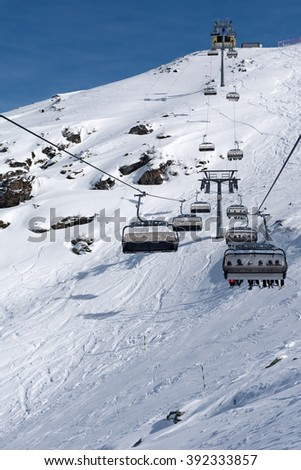 Chair-lift bringing us to the top of the mountain in the Zillertal Arena, Austria - stock photo