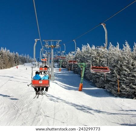 chair lift on Mount Serak for downhill skiers -  Jesenik mountains or Jeseniky - Czech republic - stock photo