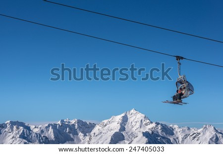 Chair Lift used by Skier in Winter - stock photo