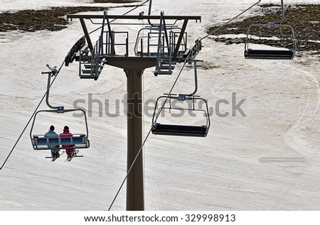 Chair lifts of Pradollano ski resort in the Sierra Nevada mountains in Spain - stock photo