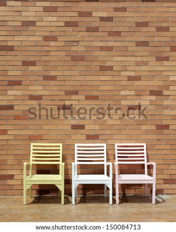 chair near old wall - stock photo
