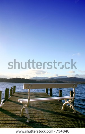 chair overlooking windamere in the lake district uk - stock photo