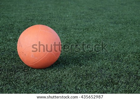 Chairball or Orange Rubber Ball. - stock photo