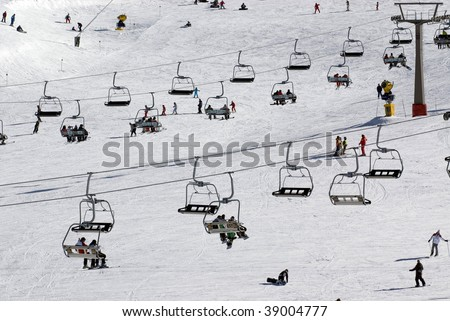 Chairlift at crowded spanish ski resort - stock photo