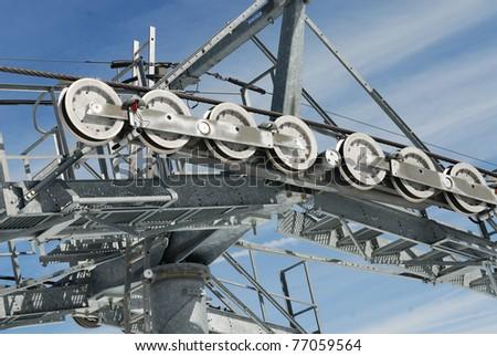 Chairlift mechanical pulleys in ski resort - stock photo