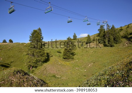 Chairlifts in summer at La Plagne, commune in the Tarentaise Valley, Savoie department and Rhone-Alpes region, in France - stock photo
