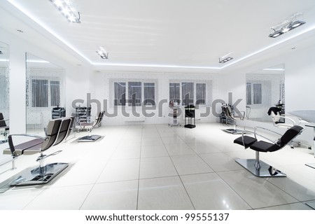 chairs and mirrors in modern hairdressing - stock photo