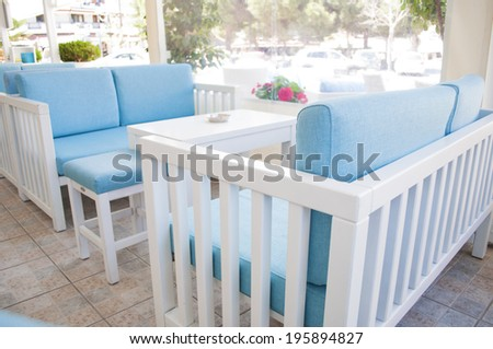 Chairs and table in the cafe bar - stock photo