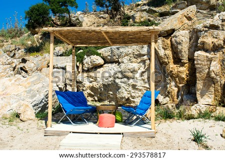 Chairs and table on the beach - stock photo
