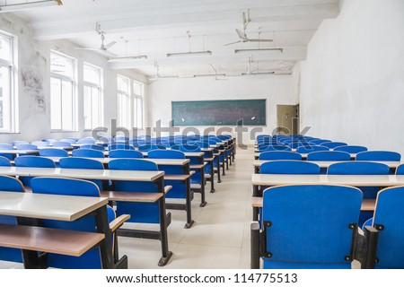 Chairs and tables in a campus classroom - stock photo