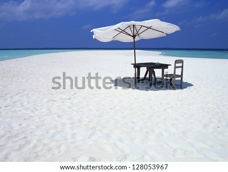 chairs and umbrella on a sand beach in Maldives - stock photo