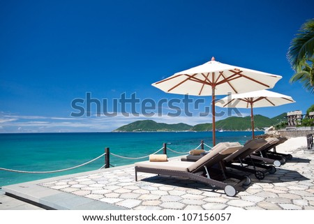 Chairs and Umbrella with Sea View - stock photo