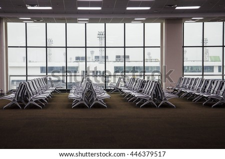 Chairs at airport lounge, airport lobby, waiting for flight - stock photo