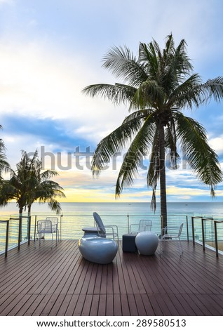 Chairs at sea side for relax at dawn - stock photo
