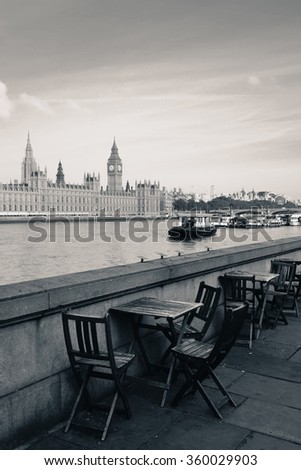 Chairs at waterfront of Thames River with Big Ben and House of Parliament in London. - stock photo