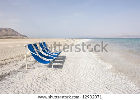 Chairs in the dead sea - stock photo