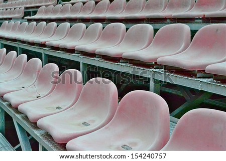 Chairs in the field. - stock photo