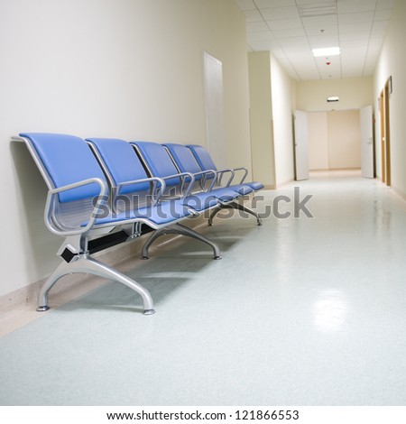 Chairs in the hospital hallway.  hospital interior - stock photo