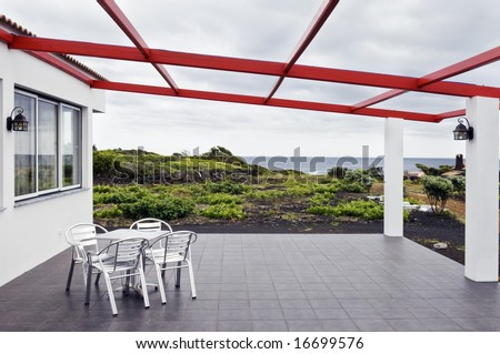 Chairs in the terrace of a seaside restaurant, Azores - stock photo