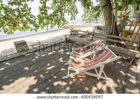 Chairs on beach near with sea - stock photo