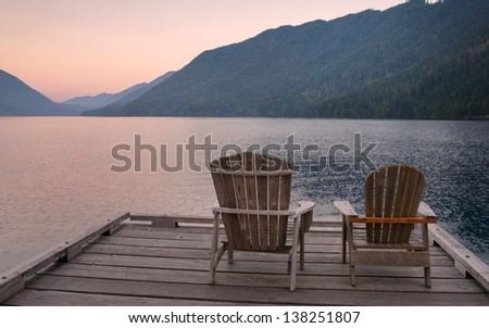 Chairs on Dock of Lake Crescent - stock photo