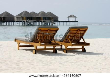 Chairs on Maldives beach - stock photo
