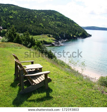 Chairs on the bank with ocean view - stock photo