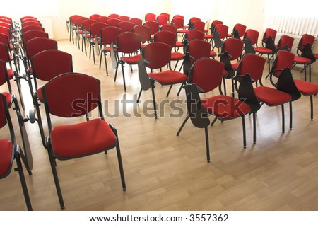 chairs rows in conference hall - stock photo