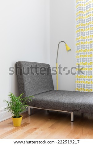 Chaise longue in the living room. Place for relaxation in a modern home. - stock photo