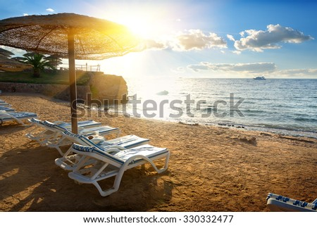 Chaise-longues on a beach of the Red sea - stock photo