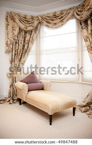 Chaise Lounge in classic bedroom - stock photo